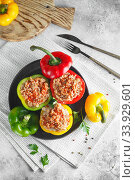 Купить «Colorful stuffed peppers with rice and minced meat. Stuffed paprika with rice and chopped meat», фото № 33929601, снято 7 мая 2019 г. (c) Nataliia Zhekova / Фотобанк Лори