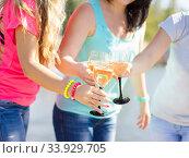 Купить «Girls having fun drinking champagne and celebrating a birthday», фото № 33929705, снято 17 сентября 2014 г. (c) Nataliia Zhekova / Фотобанк Лори