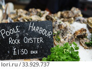 Poole harbour rock oyster with a price label. Стоковое фото, фотограф Nataliia Zhekova / Фотобанк Лори