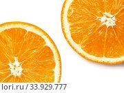 Купить «Two half juicy ripe orange isolated on white background», фото № 33929777, снято 26 января 2019 г. (c) Nataliia Zhekova / Фотобанк Лори