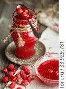 Homemade cherry jam on wooden table. Стоковое фото, фотограф Nataliia Zhekova / Фотобанк Лори