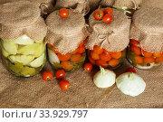 Home canning. Banks pickled tomatoes. Стоковое фото, фотограф Nataliia Zhekova / Фотобанк Лори