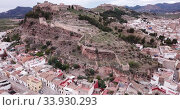 Купить «Aerial view of Sagunto city and antique roman fortress, Valencia, Spain», видеоролик № 33930293, снято 19 марта 2019 г. (c) Яков Филимонов / Фотобанк Лори