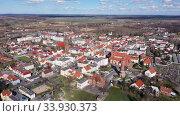 View from drone of Zmigrod townscape on sunny spring day, Lower Silesia Province, Poland. Стоковое видео, видеограф Яков Филимонов / Фотобанк Лори