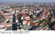 Купить «Scenic aerial view of Hradec Kralove cityscape on banks of Elbe river on sunny autumn day, Czech Republic», видеоролик № 33930377, снято 18 октября 2019 г. (c) Яков Филимонов / Фотобанк Лори