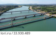Scenic aerial view of three bridges across Rhone river near small French town of Roquemaure in Gard department in sunny day (2019 год). Стоковое видео, видеограф Яков Филимонов / Фотобанк Лори