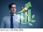 Green economy growth concept with businessman. Стоковое фото, фотограф Elnur / Фотобанк Лори