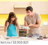 Young family struggling with personal finance. Стоковое фото, фотограф Elnur / Фотобанк Лори
