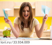 Young woman wife in budget planning concept. Стоковое фото, фотограф Elnur / Фотобанк Лори