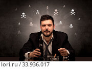 Купить «Loser drunk man sitting at table with skulls concept around», фото № 33936017, снято 4 июля 2020 г. (c) easy Fotostock / Фотобанк Лори