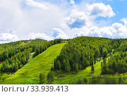 Купить «Picturesque mountain landscape on a sunny summer day», фото № 33939413, снято 25 июня 2019 г. (c) Евгений Ткачёв / Фотобанк Лори