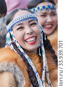 Купить «Portrait of smiling expression female in national clothing indigenous inhabitants of Kamchatka. Celebration Koryak traditional holiday Hololo Day of Seal», фото № 33939701, снято 4 ноября 2018 г. (c) А. А. Пирагис / Фотобанк Лори
