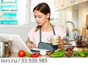 Купить «Female using her laptop at kitchen», фото № 33939985, снято 10 июля 2020 г. (c) Яков Филимонов / Фотобанк Лори