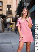 Купить «Young positive female standing in the historical center of Barcelona», фото № 33941361, снято 7 июля 2020 г. (c) Яков Филимонов / Фотобанк Лори