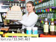saleswoman working behind counter. Стоковое фото, фотограф Яков Филимонов / Фотобанк Лори