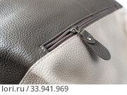 Zipper in brown leather women bag on a white background. Стоковое фото, фотограф Володина Ольга / Фотобанк Лори