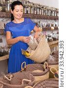 Купить «adult female choosing natural dried herbs sold by weight in eco shop», фото № 33942393, снято 13 июня 2017 г. (c) Яков Филимонов / Фотобанк Лори