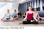 Women in lotus pose in fitness center. Стоковое фото, фотограф Яков Филимонов / Фотобанк Лори