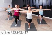 Купить «Females exercising during yoga class», фото № 33942417, снято 29 января 2018 г. (c) Яков Филимонов / Фотобанк Лори