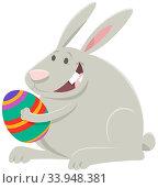 Cartoon Illustration of Funny Easter Bunny with Colored Easter Egg. Стоковое фото, фотограф Zoonar.com/Igor Zakowski / easy Fotostock / Фотобанк Лори