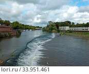 Купить «The weir on the river dee in chester with moored boats and surrounding buildings», фото № 33951461, снято 9 июля 2020 г. (c) easy Fotostock / Фотобанк Лори
