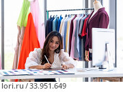 Купить «Young adult fashion designer drawing and sketching her work eith digital tablet at her atelier studio with colour palette as sole owner. Using for entrepreneur startup concept.», фото № 33951649, снято 11 июля 2020 г. (c) easy Fotostock / Фотобанк Лори