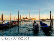 Купить «Sunset in Venice. Gondolas at Saint Mark's Square and church of San Giorgio Maggiore on background, Italy, Europe», фото № 33952561, снято 9 июля 2020 г. (c) easy Fotostock / Фотобанк Лори