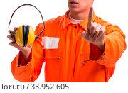 Купить «The construction worker with noise cancelling earphones», фото № 33952605, снято 5 июля 2020 г. (c) easy Fotostock / Фотобанк Лори