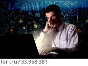 Купить «Young handsome businessman working late at night in the office with blue calculations in the background», фото № 33958381, снято 7 августа 2020 г. (c) easy Fotostock / Фотобанк Лори