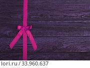 plank wood texture background with pink ribbon. Стоковое фото, фотограф Nataliia Zhekova / Фотобанк Лори