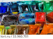 artists brushes and watercolour paints on palette. Vintage stylized photo of paintbrushes closeup and artist palette. Стоковое фото, фотограф Nataliia Zhekova / Фотобанк Лори