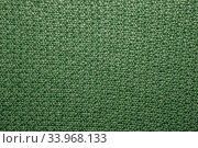 Seed stitch in green yarn as an abstract background texture. Стоковое фото, фотограф Nataliia Zhekova / Фотобанк Лори