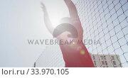 Купить «African American soccer kid in red throwing the ball in a sunny day», видеоролик № 33970105, снято 18 октября 2019 г. (c) Wavebreak Media / Фотобанк Лори