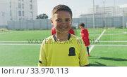 Купить «Mixed race soccer kid in red smiling and looking at camera», видеоролик № 33970113, снято 18 октября 2019 г. (c) Wavebreak Media / Фотобанк Лори