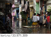Купить «People are seen walking through flood water, during the floods in Muara Baru, Jakarta, Indonesia, on June 6, 2020. Floods in Jakarta, this is a phenomenon...», фото № 33971309, снято 6 июня 2020 г. (c) age Fotostock / Фотобанк Лори