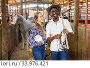 Купить «Portrait of couple of horse farm workers», фото № 33976421, снято 2 октября 2018 г. (c) Яков Филимонов / Фотобанк Лори