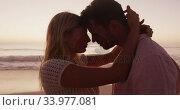 Купить «Caucasian couple enjoying time at the beach during the sunset», видеоролик № 33977081, снято 25 февраля 2020 г. (c) Wavebreak Media / Фотобанк Лори