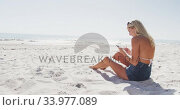 Купить «Caucasian woman using her smartphone on the beach», видеоролик № 33977089, снято 25 февраля 2020 г. (c) Wavebreak Media / Фотобанк Лори