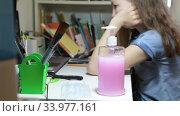 Medical mask and liquid antiseptic gel are on desk for school age girl, protection from the coronavirus. Стоковое видео, видеограф Кекяляйнен Андрей / Фотобанк Лори