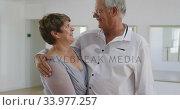 Купить «Caucasian senior couple spending time together in a ballroom», видеоролик № 33977257, снято 8 ноября 2019 г. (c) Wavebreak Media / Фотобанк Лори