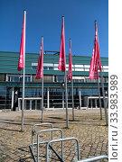 Купить «Germany, Bremen - Hanging flags of the Bremen Fair in front of hall 4 at the Buergerweide», фото № 33983989, снято 23 апреля 2020 г. (c) Caro Photoagency / Фотобанк Лори