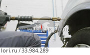 African American male car mechanic holding a screwdriver and using a hammer to repair a car. Стоковое видео, агентство Wavebreak Media / Фотобанк Лори