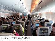 Frankfurt am Main, Germany, Passengers in an aircraft cabin (2019 год). Редакционное фото, агентство Caro Photoagency / Фотобанк Лори