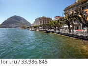 Town of Lugano at the lake Lugano, surrounded by Alps. View of the San Salvatore mountain. Canton of Ticino, Switzerland, Europe. (2018 год). Редакционное фото, фотограф Bala-Kate / Фотобанк Лори