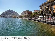 Купить «Town of Lugano at the lake Lugano, surrounded by Alps. View of the San Salvatore mountain. Canton of Ticino, Switzerland, Europe.», фото № 33986845, снято 17 апреля 2018 г. (c) Bala-Kate / Фотобанк Лори