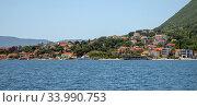 Купить «View of the typical town in Kotor Bay, Montenegro», фото № 33990753, снято 10 июня 2019 г. (c) Володина Ольга / Фотобанк Лори