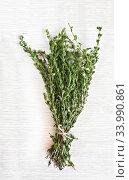 bunch fresh thyme on a wooden table background. Стоковое фото, фотограф Tetiana Chugunova / Фотобанк Лори