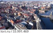Купить «Picturesque aerial view of Wroclaw on Oder River bank overlooking historical Market Square with Old Town Hall», видеоролик № 33991469, снято 14 марта 2020 г. (c) Яков Филимонов / Фотобанк Лори
