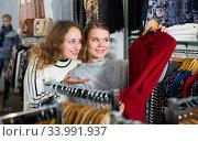 Two women choosing new blouse. Стоковое фото, фотограф Яков Филимонов / Фотобанк Лори