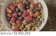 Купить «Top view of cooking healthy breakfast from falling fresh organic», видеоролик № 33992253, снято 6 июля 2020 г. (c) Ярослав Данильченко / Фотобанк Лори